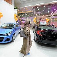 Illustrative: A Saudi woman tours a car showroom for women in Jeddah, Saudi Arabia, on January 11, 2018. (AFP/Amer Hilabi)