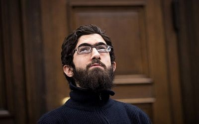 Ahmad Alhaw, a 26-year-old Palestinian man, waits in a courtroom on January 12, 2018 in Hamburg. (AFP PHOTO / POOL / Christian Charisius)