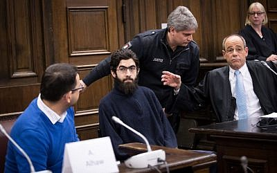 Ahmad Alhaw, a 26-year-old Palestinian man, waits in a courtroom next to his lawyer Christoph Burchard (R) and a translator on January 12, 2018 in Hamburg. (AFP/Pool/Christian Charisius)