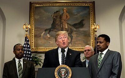 US Secretary of Housing and Urban Development Ben Carson (L), US Vice President Mike Pence (2R) and Isaac Newton Farris Jr. (R) listen while US President Donald Trump speaks during an event about Martin Luther King Jr. in the Roosevelt Room of the White House January 12, 2018. (AFP Photo/Brendan Smialowski)