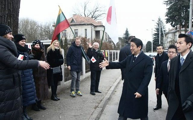 Japan's Prime Minister Shinzo Abe arrives at the Sugihara House in Kaunas, Lithuania, on January 14, 2018. (AFP Photo/Petras Malukas)