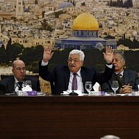 Palestinian Authority President Mahmoud Abbas (C-R) speaks during a meeting in the West Bank city of Ramallah on January 14, 2018.(AFP PHOTO / ABBAS MOMANI)