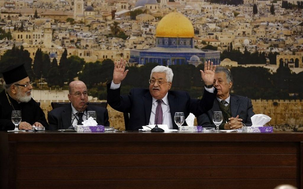 "Illustrative: Palestinian president Mahmoud Abbas (C-R) speaks during a meeting in the West Bank city of Ramallah on January 14, 2018. Abbas said that Israel has ""ended"" the landmark Oslo peace accords of the 1990s with its actions. (AFP PHOTO / ABBAS MOMANI)"