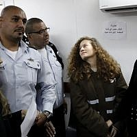 Sixteen-year-old Palestinian Ahed Tamimi (2nd right) stands for a hearing in the Israeli military court at Ofer military prison in the West Bank, on January 15, 2018. (AFP PHOTO / THOMAS COEX)