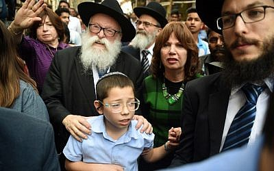 Moshe Holtzberg, son of slain Rabbi Gavriel Holtzberg who was killed along with his wife in the November 26, 2008 attacks, reacts as he arrives with his grandparents at the Chabad house in Mumbai on January 16, 2018. (AFP PHOTO / PUNIT PARANJPE)
