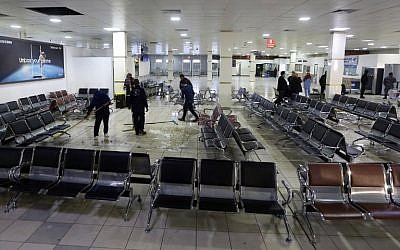 Libyans clean inside Mitiga airport the day after militiamen attacked it in an attempt to free colleagues held at a jail there, on the eastern outskirts of the Libyan capital Tripoli, on January 16, 2018. (AFP PHOTO / Mahmud TURKIA)
