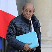 French Foreign Affairs Minister Jean-Yves Le Drian leaves the Elysee palace after the weekly cabinet meeting on January 17, 2018, in Paris. (AFP Photo/Ludovic Marin)