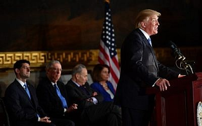 US President Donald Trump  speaks during a ceremony to present the Congressional Gold Medal to former Republican US Senate Majority Leader Bob Dole, at the US Capitol on January 17, 2018 in Washington, DC. (AFP PHOTO / Nicholas Kamm)