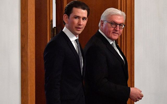 German President Frank-Walter Steinmeier, right, and Austria's Chancellor Sebastian Kurz arrive on January 18, 2018 for a guest book signing ceremony at the presidential Bellevue Palace in Berlin. (AFP/John MACDOUGALL)