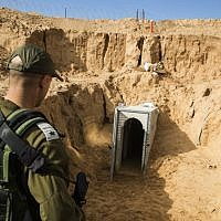 An Israeli army officer looks at a destroyed Palestinian Islamic Jihad tunnel, leading from Gaza into Israel, near the southern Israeli kibbutz of Kissufim, January 2018. (Jack Guez/AFP/POOL)