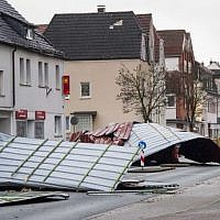 Metal roofing sheets from a supermarket blocking a road in Menden, western Germany, as the region is hit by the storm named 'Friederike,' January 18, 2018. (AFP Photo/dpa/Markus Kluemper/Germany OUT)
