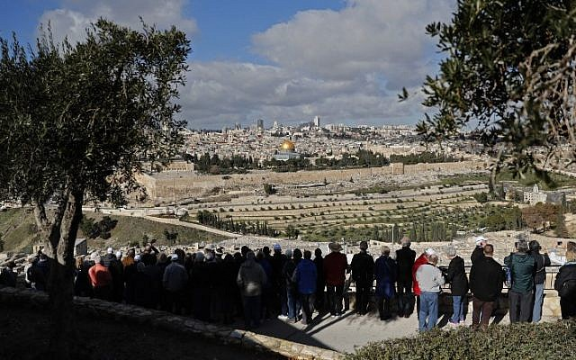 Members of a group of American Baptist Christian tourists stand at the Mount of Olives as they look toward Jerusalem's Old City and the Dome of the Rock on January 20, 2018  (AFP PHOTO / THOMAS COEX)