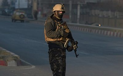 An Afghan security forces member keeps watch near the Intercontinental Hotel following an attack in Kabul