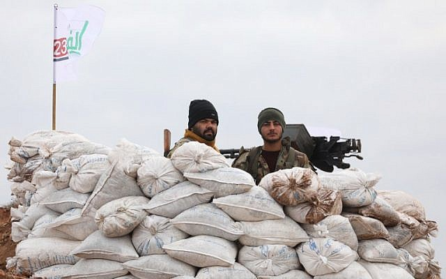 Turkish-backed Syrian rebel fighters man a monitoring point near the Syrian village of Qilah, in the southwestern edge of the Afrin region close to the border with Turkey, on January 21, 2018. (AFP/ OMAR HAJ KADOUR)