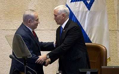 US Vice President Mike Pence (R) shakes hands with Prime Minister Benjamin Netanyahu at the Knesset in Jerusalem on January 22, 2018. (AFP Photo/Pool/Ariel Schalit)
