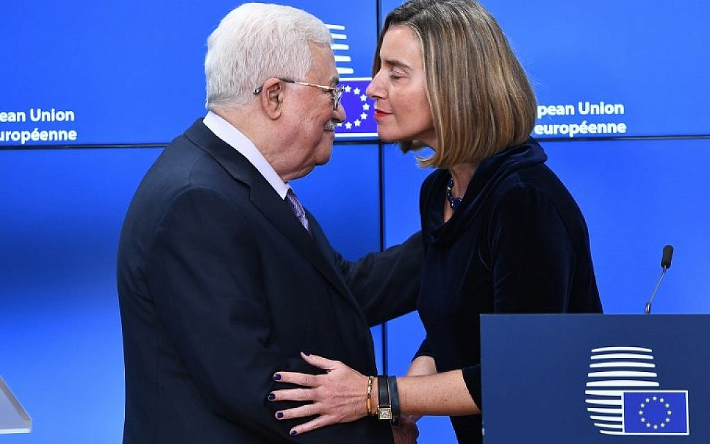 Palestinian Authority President Mahmoud Abbas (L) is welcomed by EU foreign policy chief Federica Mogherini prior to attending a EU foreign affairs council at the European Council in Brussels, January 22, 2018. (EMMANUEL DUNAND / AFP)