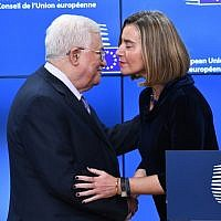 Palestinian Authority President Mahmoud Abbas (L) is welcomed by EU foreign policy chief Federica Mogherini prior to attend a EU foreign affairs council at the European Council in Brussels, January 22, 2018. (EMMANUEL DUNAND / AFP)