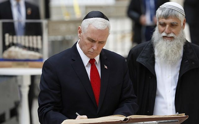 US Vice President Mike Pence (L) signs the guest book during a visit to Jerusalem's Western Wall on January 23, 2018. (AFP PHOTO / Thomas COEX)
