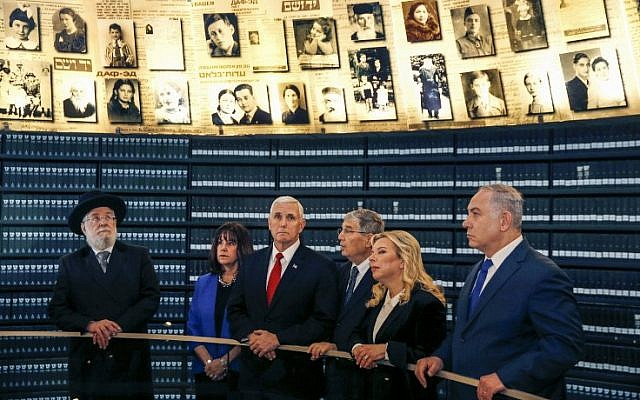 US Vice President Mike Pence (C) and his wife Karen (2nd L), Yad Vashem Chairman Council Rabbi Israel Meir Lau (L), Yad Vashem Director Avner Shalev (3rd R), Prime Minister Benjamin Netanyahu (R) and wife Sara Netanyahu (2nd-R) visit the Hall of Names in Yad Vashem Holocaust History Museum in Jerusalem, January 23, 2018. (AFP PHOTO / POOL / RONEN ZVULUN)