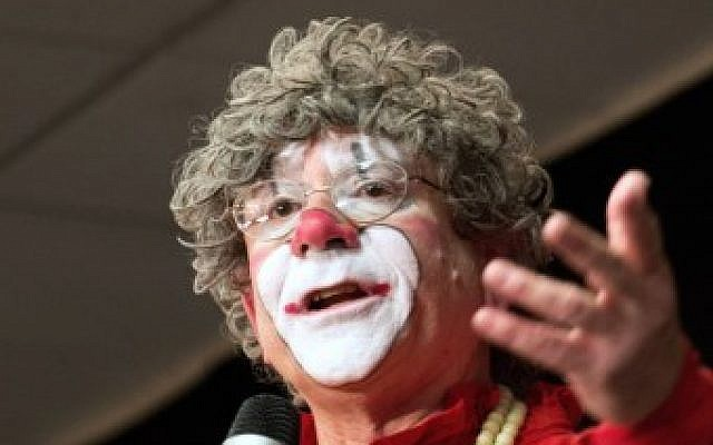 This file photo taken on March 28, 2014, shows noted clown Barry Lubin giving advisc to hundreds of clowns after headlining the World Clowning Association annual convention in Northbrook, Illinois. (AFP Photo/Derek R. Henkle)