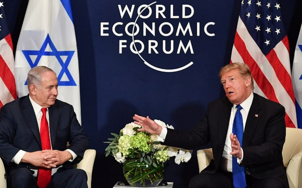 US President Donald Trump (right) speaks with Israel's Prime Minister Benjamin Netanyahu during a bilateral meeting on the sidelines of the World Economic Forum (WEF) annual meeting in Davos, Switzerland, on January 25, 2018. (AFP PHOTO / Nicholas Kamm)