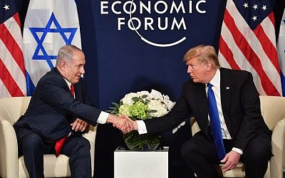 US President Donald Trump (right) and Prime Minister Benjamin Netanyahu, during a bilateral meeting on the sidelines of the World Economic Forum (WEF) annual meeting in Davos, Switzerland, on January 25, 2018. (AFP Photo/Nicholas Kamm)