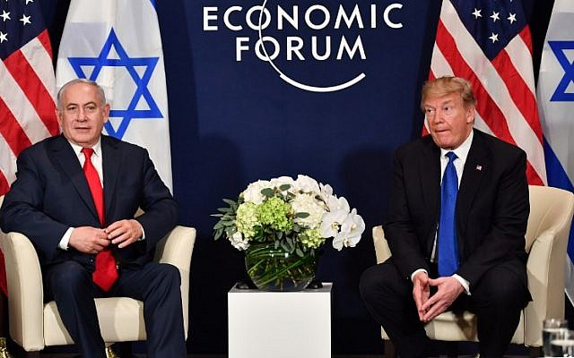 US President Donald Trump and Prime Minister Benjamin Netanyahu meet on the sidelines of the World Economic Forum in Davos, Switzerland, on January 25, 2018 (AFP Photo/Nicholas Kamm)