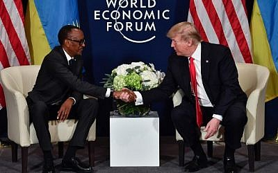 US President Donald Trump (R) shakes hands with Rwandan President President Paul Kagame during a bilateral meeting on the sideline of the annual meeting of the World Economic Forum (WEF) on January 26, 2018 in Davos, eastern Switzerland. ( AFP PHOTO / Nicholas Kamm)
