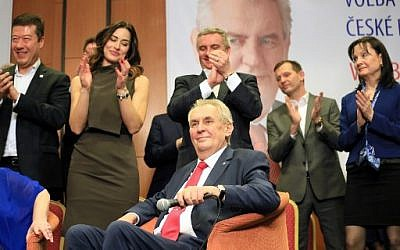 Pro-Russian incumbent Milos Zeman is applauded as he celebrates his victory with his staff members after he was reelected Czech President on January 27, 2018 at the Top hotel in Prague. (AFP / RADEK MICA)