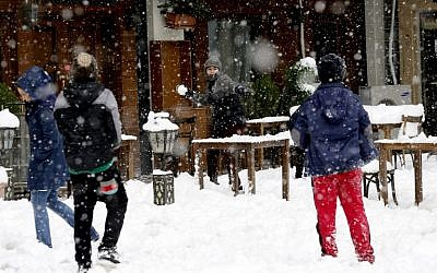Iranian youth play in the snow in the capital Tehran on January 28, 2018. (AFP/ATTA KENARE)