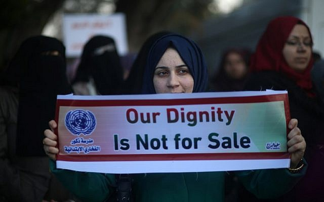 Palestinian women take part in a protest in Gaza City on January 29, 2018, against the US move to freeze funding for the UN agency for Palestinian refugees, UNRWA. (MOHAMMED ABED / AFP)