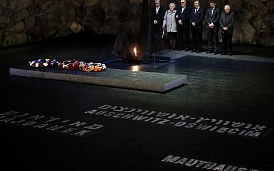 Alicja Mularska (2L), the daughter of the late Polish couple Jan Dziadosz and Sabina Perzyna, stands with her family after receiving the Righteous Among the Nations award on behalf of her parents during a posthumous ceremony honoring them and their son Aleksandr Dziadosz at Yad Vashem on January 30, 2018. (AFP PHOTO / THOMAS COEX)