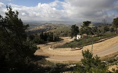 The border fence between Israel and Lebanon with the southern Lebanese village of Blida in the background, from the Israeli kibbutz of Yiftah, on January 30, 2018. (AFP Photo/Jalaa Marey)