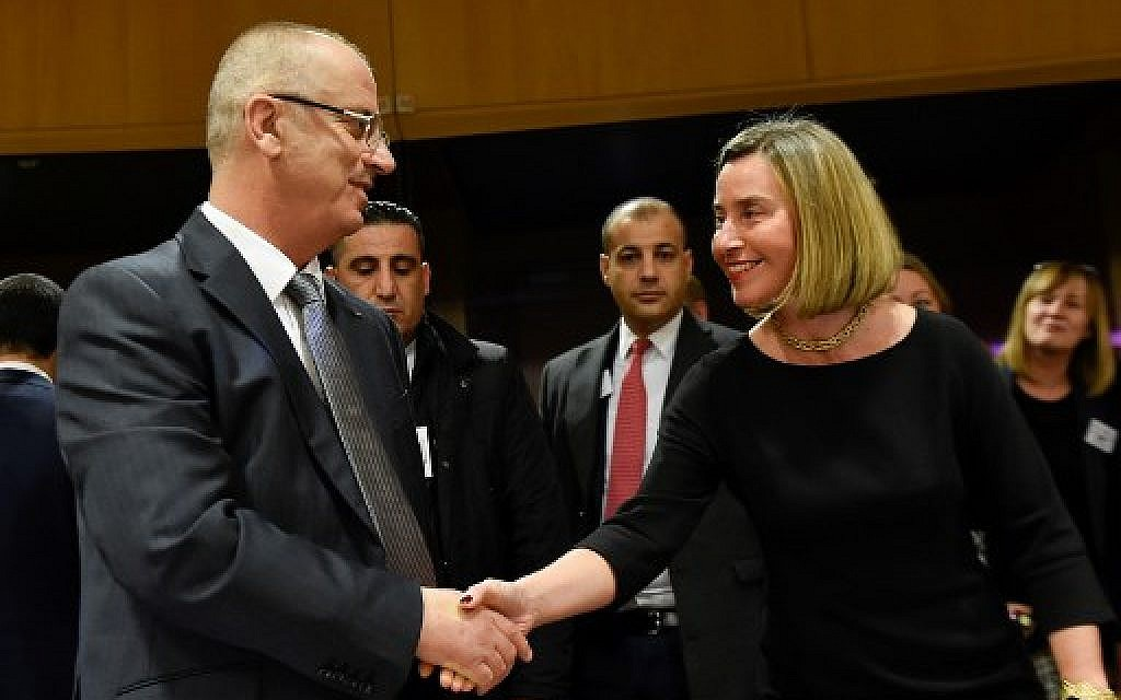 High Representative of the Union for Foreign Affairs and Security Policy Federica Mogherini (R) welcomes Palestinian Authority Prime Minister Rami Hamdallah (L) prior to an extraordinary international Palestine donors meeting at the EU headquarters in Brussels on January 31, 2018.  ( AFP PHOTO / JOHN THYS)