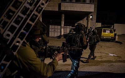 Illustrative: Israeli soldiers search the area around the West Bank city of Nablus on January 11, 2018, as part of a manhunt after the perpetrators of a lethal terror attack outside a nearby settlement. (Israel Defense Forces)