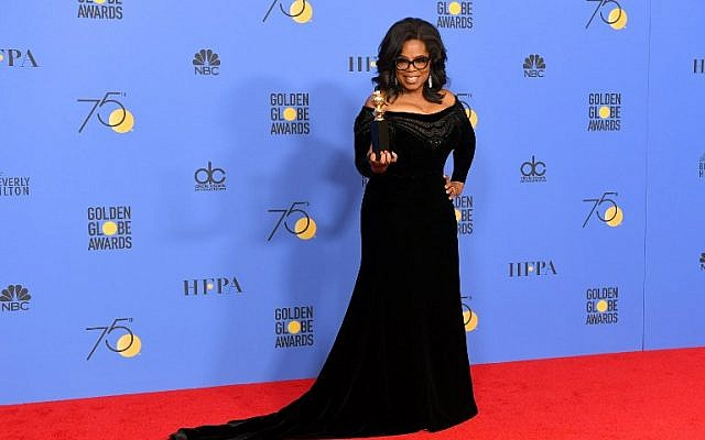 Oprah Winfrey poses with the Cecil B. DeMille Award in the press room during The 75th Annual Golden Globe Awards at The Beverly Hilton Hotel, in Beverly Hills, California, January 7, 2018.  (Kevin Winter/Getty Images/AFP)