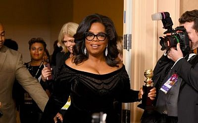 Oprah Winfrey arrives with the Cecil B. DeMille Award in the press room during The 75th Annual Golden Globe Awards at The Beverly Hilton Hotel on January 7, 2018 in Beverly Hills, California.  (Kevin Winter/Getty Images/AFP)