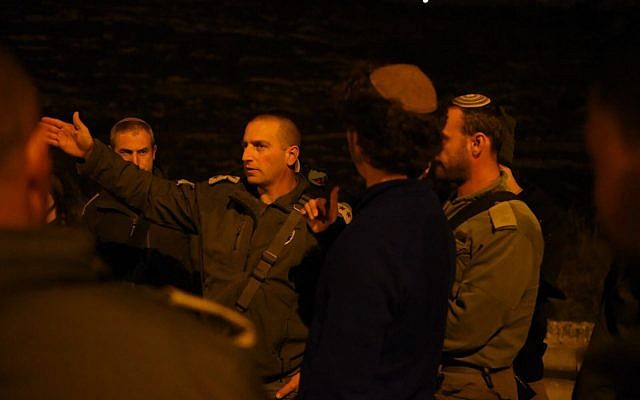 The head of the army's northern West Bank's Samaria Brigade speaks with officers and soldiers after a terror attack in the area on January 10, 2018. (Israel Defense Forces)