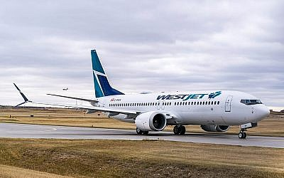Illustrative: A WestJet passenger plane at Calgary International Airport in September 2017. (CC BY-SA Wikimedia Commons)
