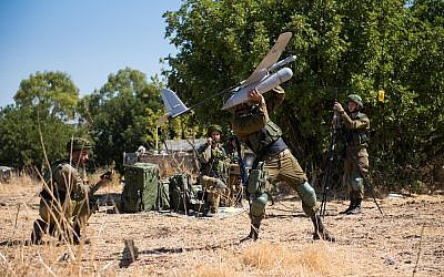Soldiers from the IDF's Sky Riders Unit launch a Skylark drone during an exercise in an undated photograph. (Israel Defense Forces)