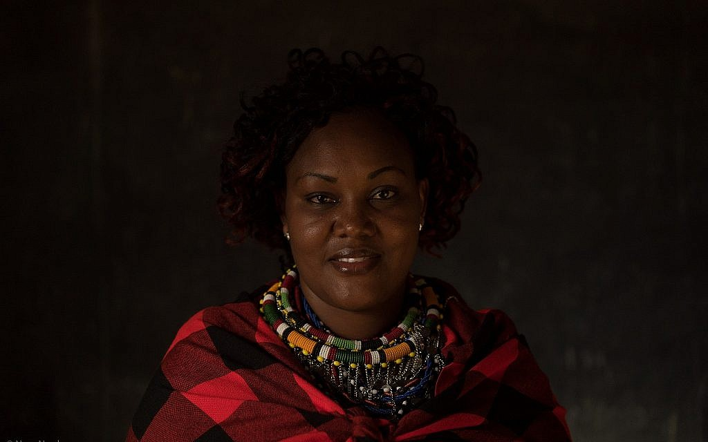 Portrait of a Nashulai Conservancy scout and member of the Maasai community. (Nora Nord)
