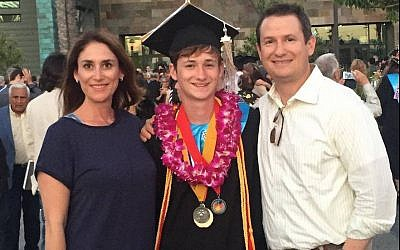 Blaze Bernstein, center, with his parents, Jeanne Pepper and Gideon Bernstein. (Facebook via JTA)