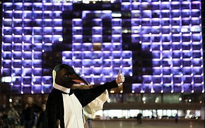 Tel Aviv city hall is seen lit up as a penguin in honor of Penguin Awareness Day on January 20, 2018.(Dor Nevo/Greenpeace)