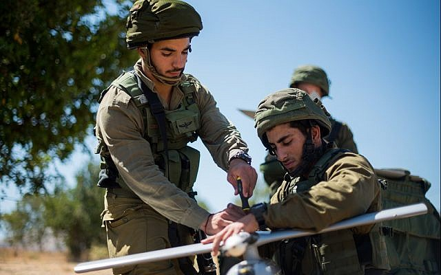 Soldiers from the IDF's Sky Riders Unit work on a Skylark drone during an exercise in an undated photograph. (Israel Defense Forces)