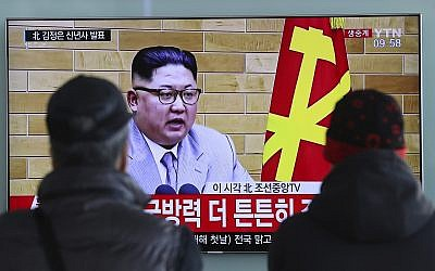 South Koreans watch a TV news program showing North Korean leader Kim Jong Un's New Year's speech, at the Seoul Railway Station in Seoul, South Korea, January 1, 2018. (AP Photo/Lee Jin-man)
