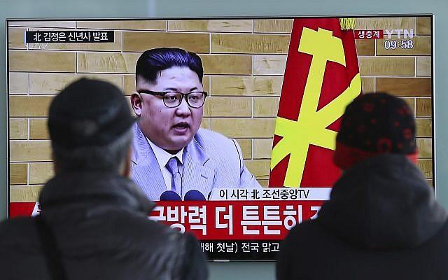 South Koreans watch a TV news program showing North Korean leader Kim Jong Un's New Year's speech, at the Seoul Railway Station in Seoul, South Korea, January 1, 2018. (AP Photo/Lee Jin-man)