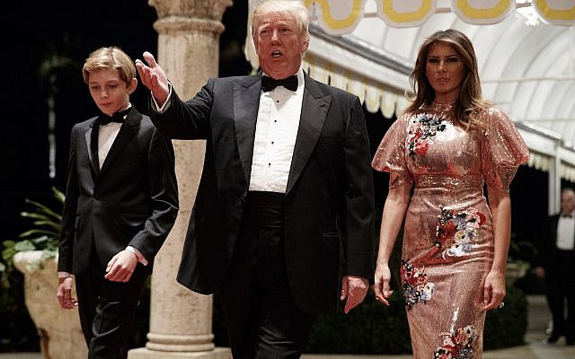 President Donald Trump, first lady Melania Trump, and their son Barron arrive for a New Year's Eve gala at his Mar-a-Lago resort Sunday, December 31, 2017, in Palm Beach, Fla. (AP/Evan Vucci)