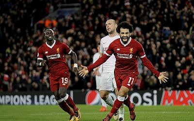 In this December 6, 2017 photo, Liverpool's Mohamed Salah, right, celebrates after scoring his side's seventh goal during the Champions League Group E soccer match in Liverpool, England. (AP Photo/Rui Vieira)