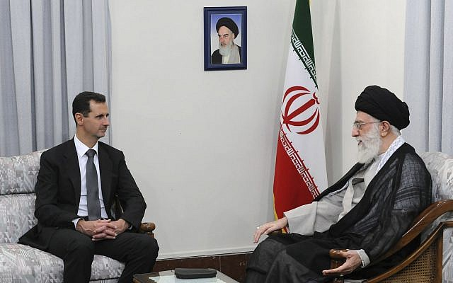 In this file photo from October 2, 2010, released by the official website of the Iranian supreme leader's office, Iranian Supreme Leader Ayatollah Ali Khamenei, right, talks with Syrian President Bashar Assad in Tehran, Iran.   (Office of the Supreme Leader, via AP, File)