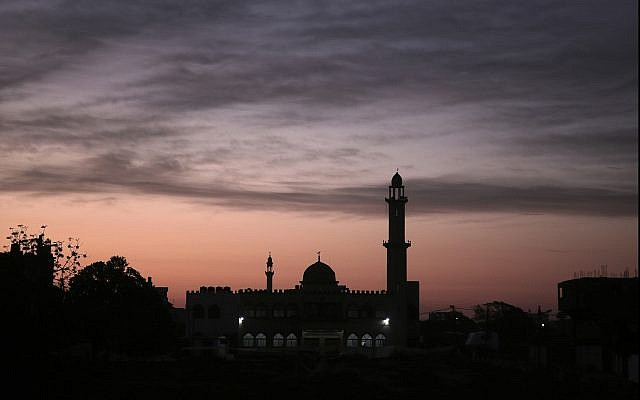 In this photo from January 3, 2018, the sun rises over a mosque in Gaza City. (AP Photo/Khalil Hamra)